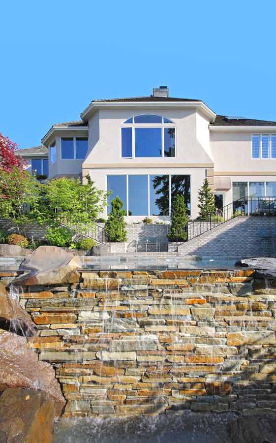 Beautiful Home Exterior with Manmade Waterfall stock photo