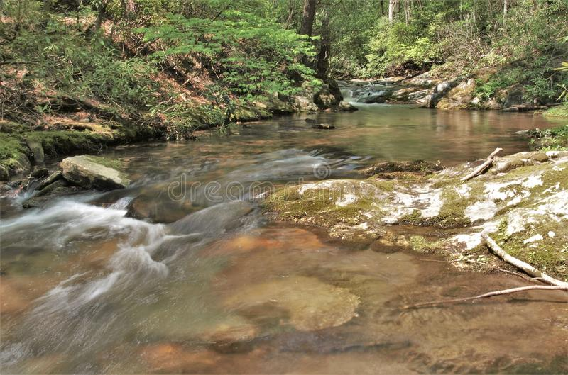 Rich Mountain Creek in Stone Mountain State Park. Water cascades over mossy rocks in Rich Mountain Creek. Stone Mountain State Park in Low Gap, North Carolina royalty free stock image