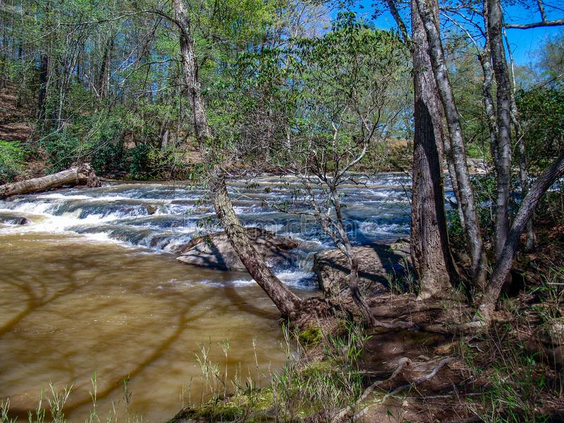 Rocky Shoals above Carter Falls. Water cascades over a series of rocky shoals above Carter Falls near Elkin, North Carolina stock images