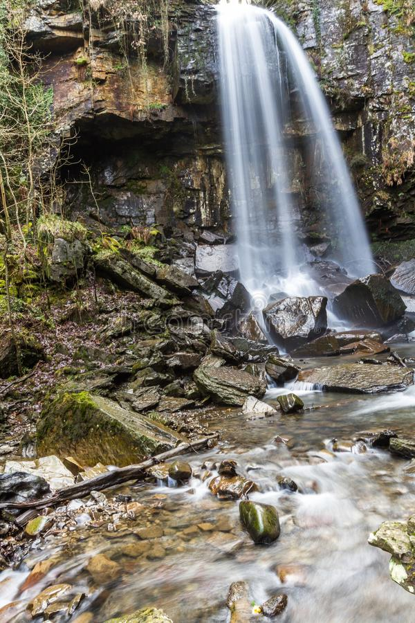 Water cascading down beautiful waterfall, Melincourt, portrait royalty free stock images