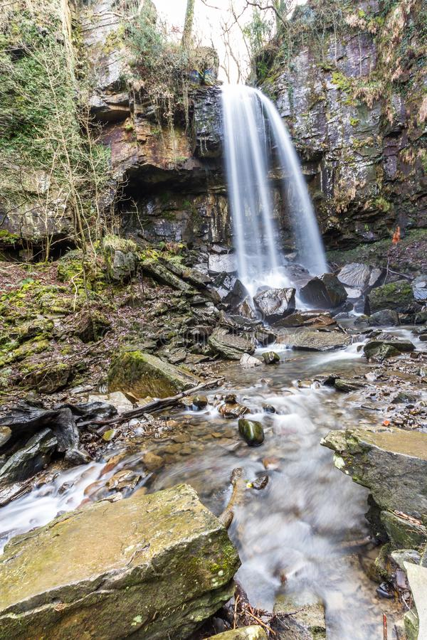 Water cascading down beautiful waterfall, Melincourt, portrait, wide angle stock image