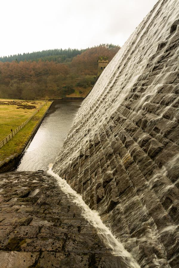Water cascading down stone dam, Ladybower reservoir. royalty free stock images