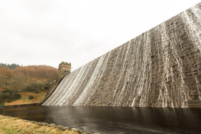Water cascading down stone dam, Ladybower reservoir. stock image