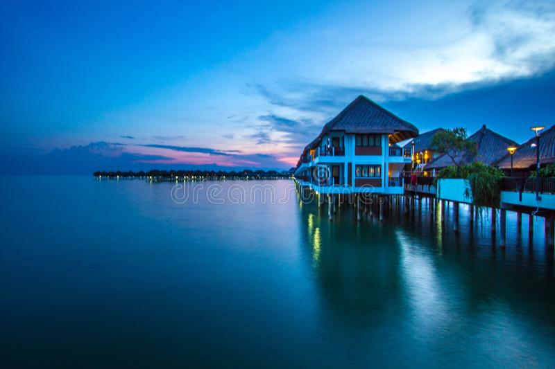 Water chalets by night. Water holiday chalets by night stock photography