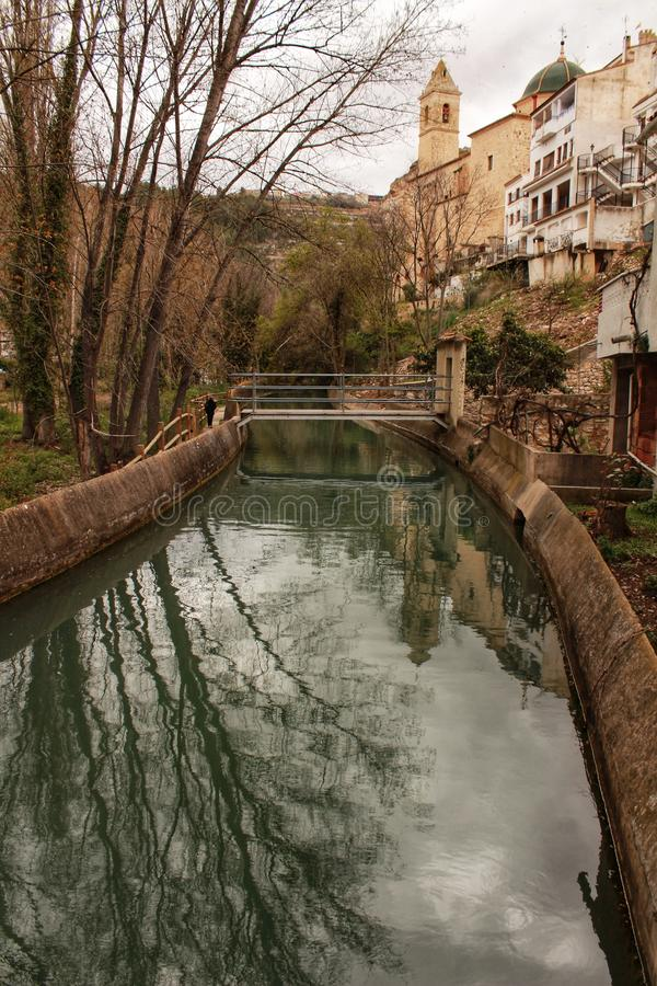 Water channel in Alcala del Jucar. And vegetation royalty free stock photography