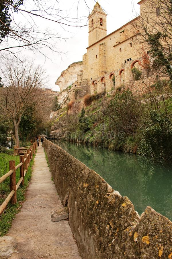 Water channel in Alcala del Jucar. And vegetation royalty free stock photo
