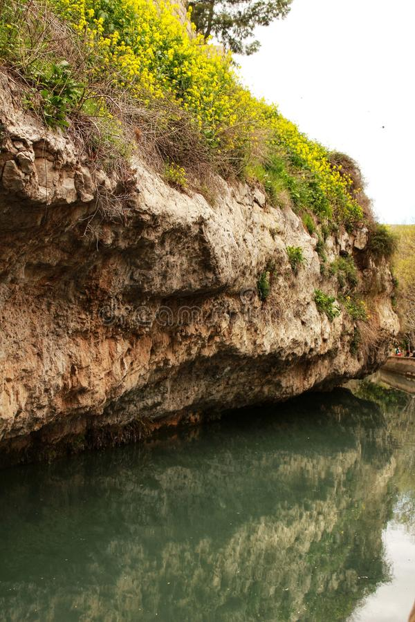 Water channel in Alcala del Jucar. And vegetation stock photography