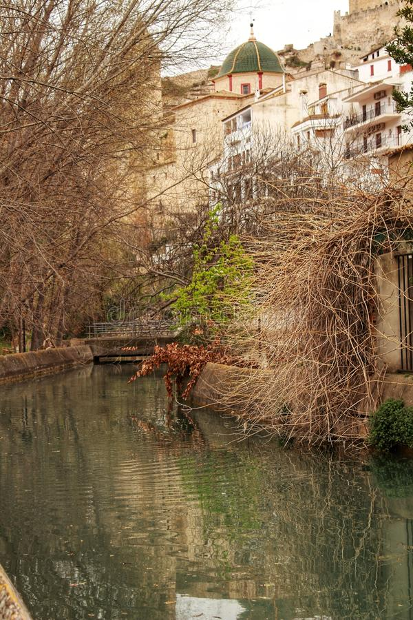 Water channel in Alcala del Jucar. And vegetation stock image