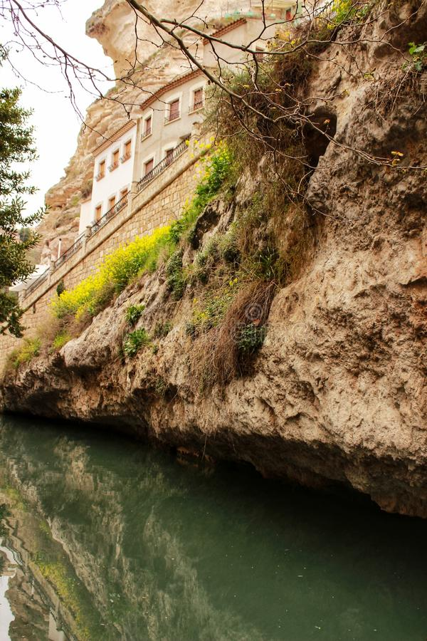 Water channel in Alcala del Jucar. And vegetation stock photo