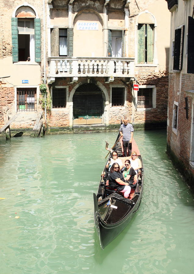 Water channel with gondola in Venice. Water channel with gondola in front of Hotel Caneva in channel Rio de San Zulan in Venice (Italy royalty free stock photo