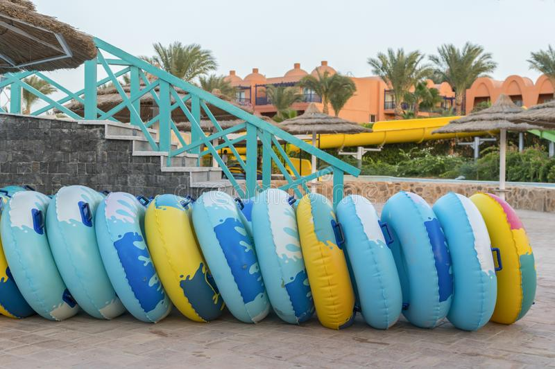water circles for water slides. inflatable wheels for high-speed descent from the slides stock photos