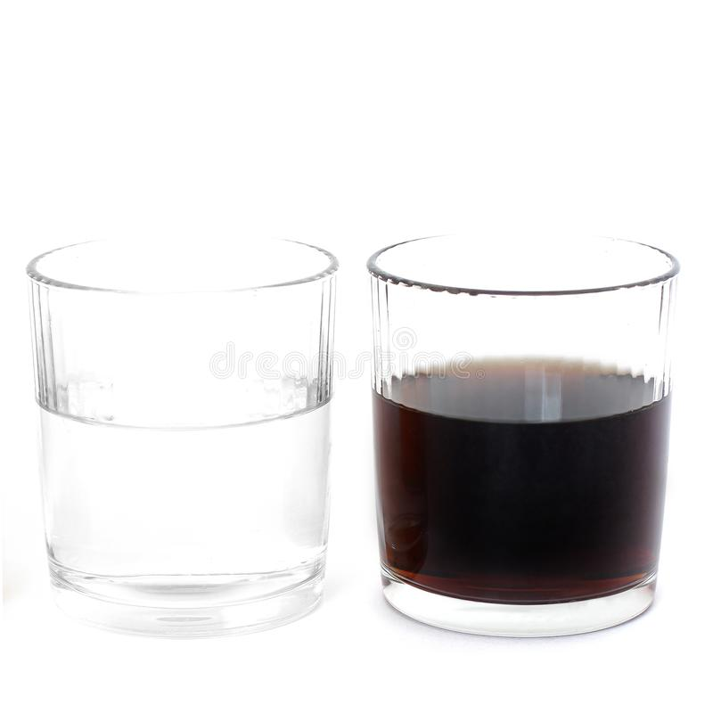 Water and cola in glasses on a white background. Drink.  stock photos