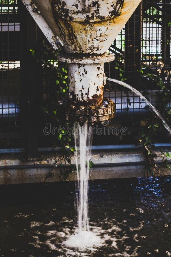 Water Coming Out Of A Pipe royalty free stock photos