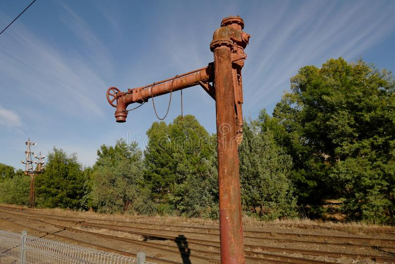Old rusted railway water crane royalty free stock photography