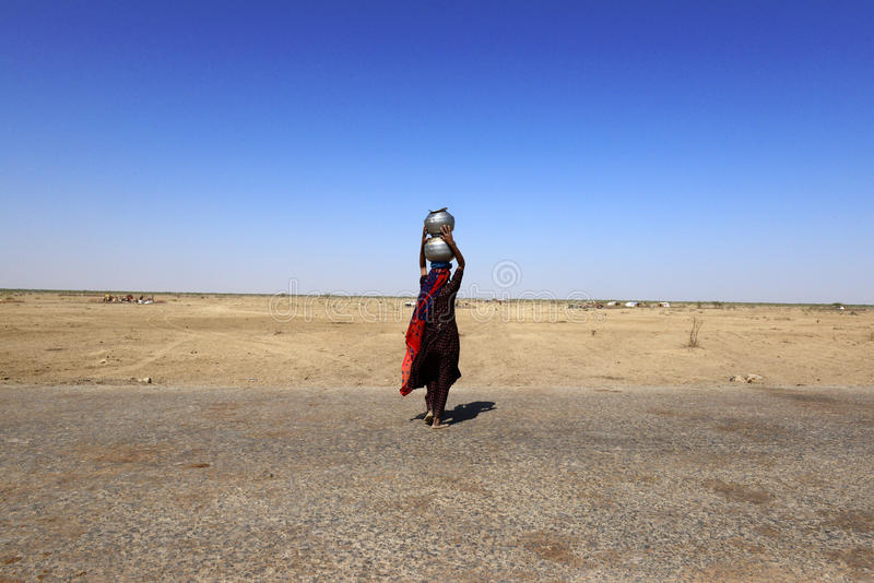 Water Crisis. In rural areas of women are spending increasing amounts of time and energy travelling long distances to get water. In some dry regions of Kutch stock images