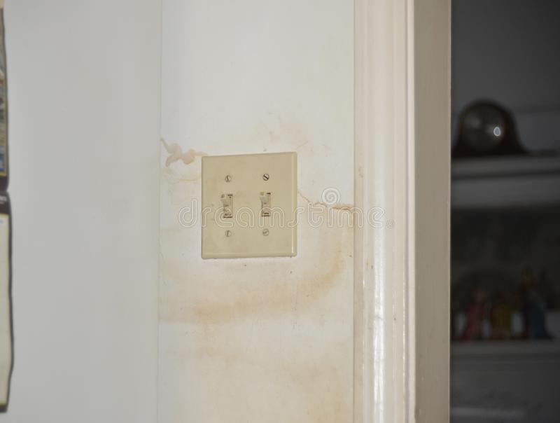 Water Damage Stained Drywall. Drywall that has sustained water damage from a leaky roof, flooding, or a busted pipe in the wall stock images