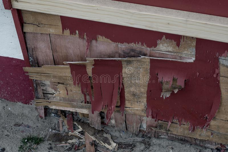 Damaged wooden panel with peeling paint. stock photos