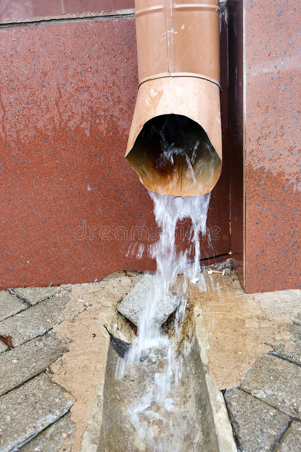 Water from the drain pipe stock photography