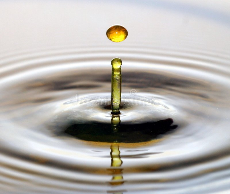 Water drop. Glycol drop into water stock image