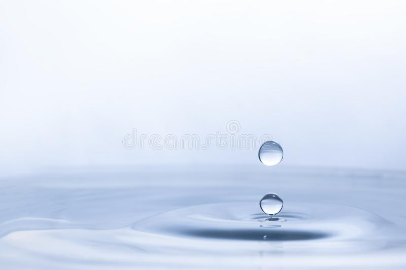Water drop on water background stock images