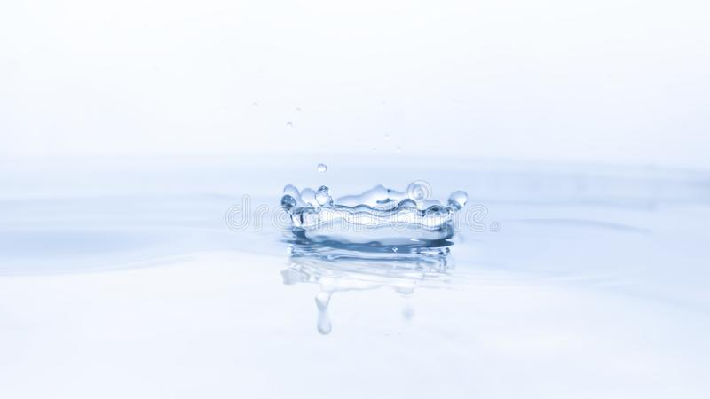Water drop on water background stock photos