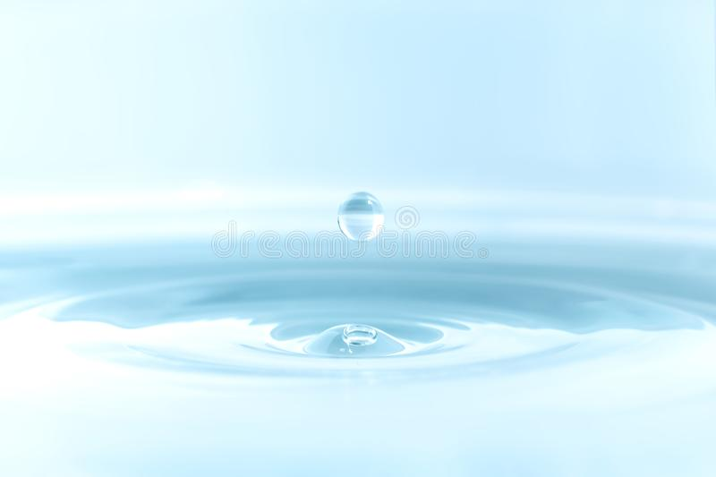 Water drop on water background royalty free stock photography