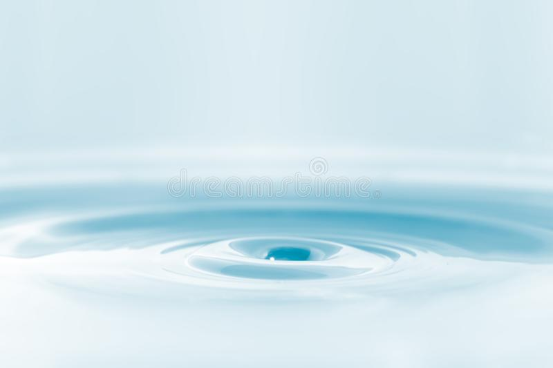 Water drop on water background royalty free stock images