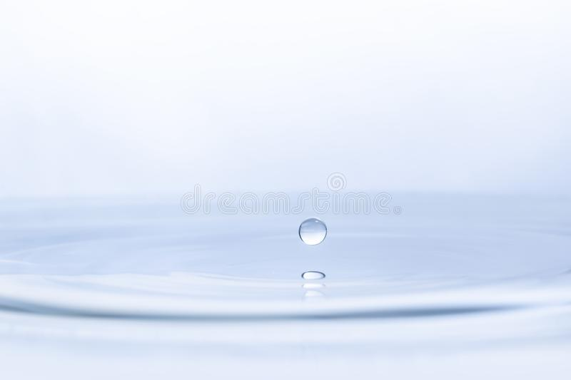 Water drop on water background royalty free stock image