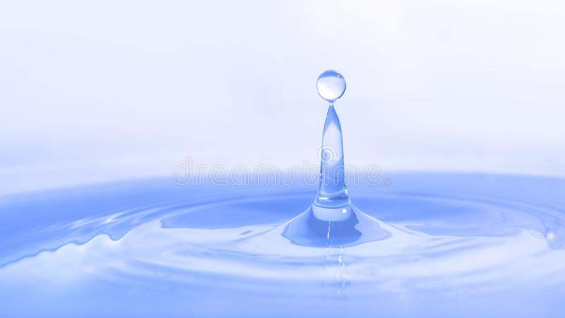 Water drop on water background royalty free stock photos