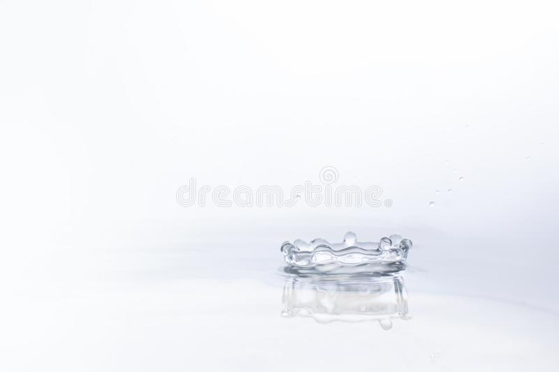 Water drop on water background stock image