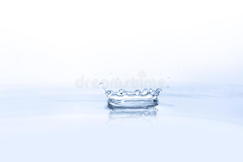 Water drop on water background stock photography