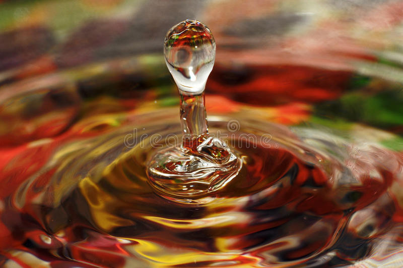 Water drop. On colorful background abstract splash