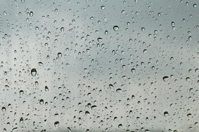 Water drop fresh condensation on window glass texture, rainy season wet background cooling feels and cold, raindrops texture wet t royalty free stock image