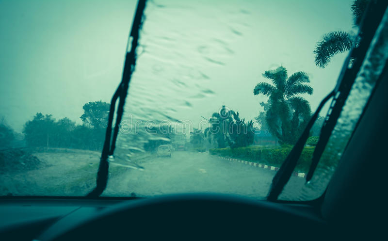Water drop on glass mirror. Wiper on a wet windshield. Nature background stock images