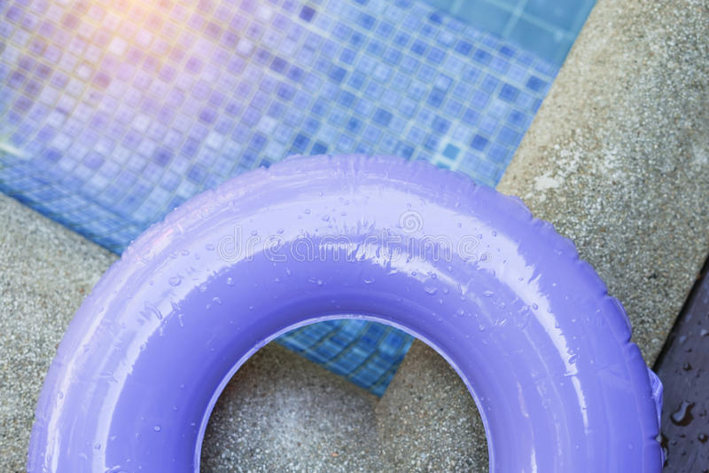 Water drop on part of purple ring pool. In soft focus stock photo
