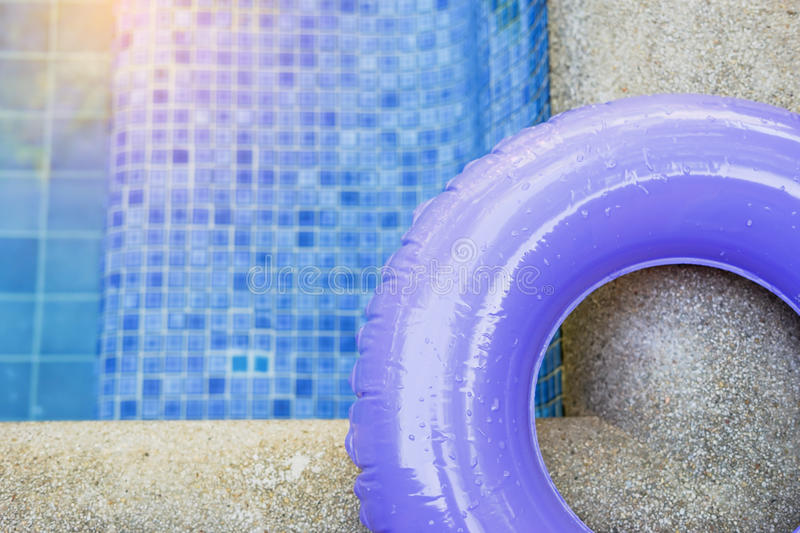 Water drop on part of purple ring pool. In soft focus stock photography