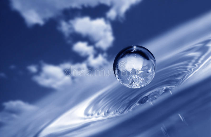 Water drop on sky background stock image