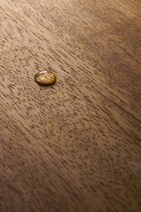 Water droplets on a wooden surface. Water drop on a wooden surface backgtound texture royalty free stock photo
