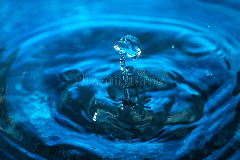 Water droplet on blue background. Amazing abstract water shot for texture. Nature concept. Water droplet on blue background. Amazing abstract water shot for royalty free stock photography