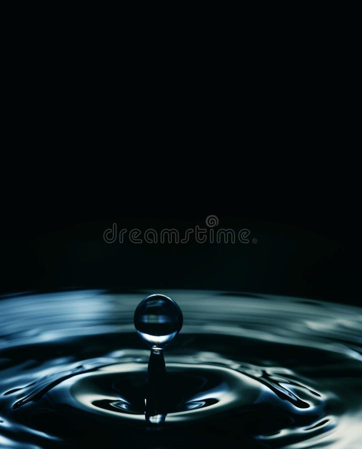 Water droplet blue black colors. Stylish wavy abstract background. macro view, copy space. selective focus.  royalty free stock photography