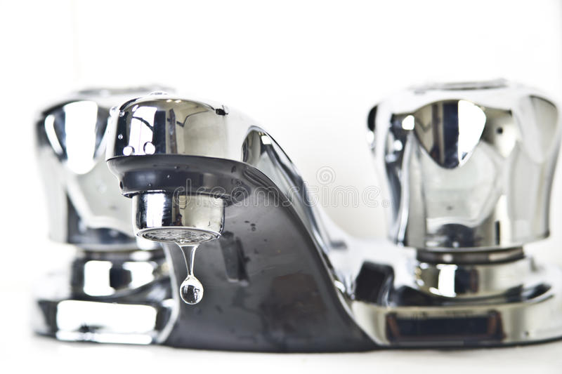 Water droplet on faucet royalty free stock photo