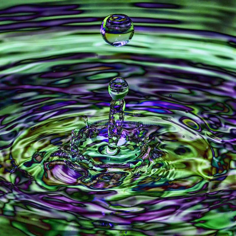 Iridescent transparent ripple splash stock image