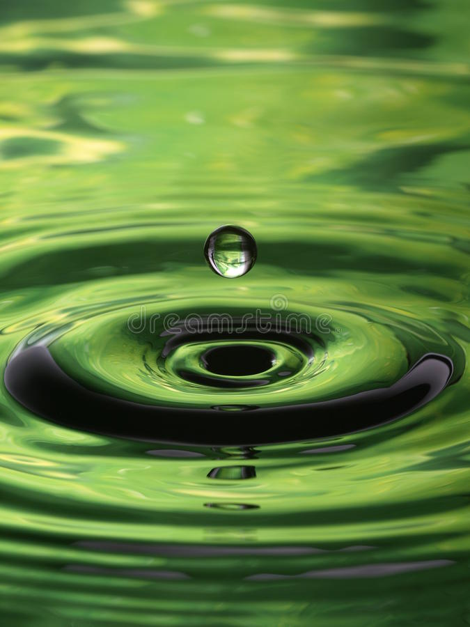 Water Droplet Ripple Pattern green single drop. Water Droplet Ripple Pattern with green single drop royalty free stock photos