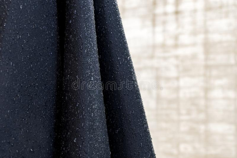 Water droplets on blue fabric. Abstract background royalty free stock photography