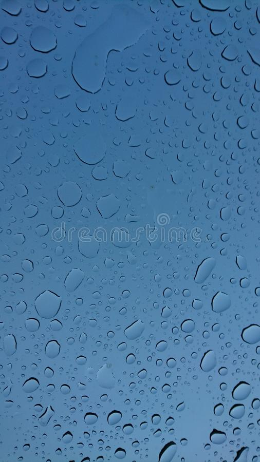 Water droplets on blue heaven background stock photography