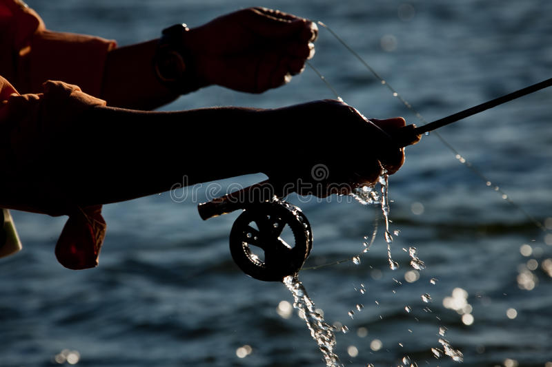 Water droplets fly fishing royalty free stock photo