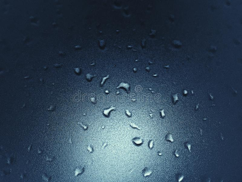 Water Droplets on Glass Surface stock image