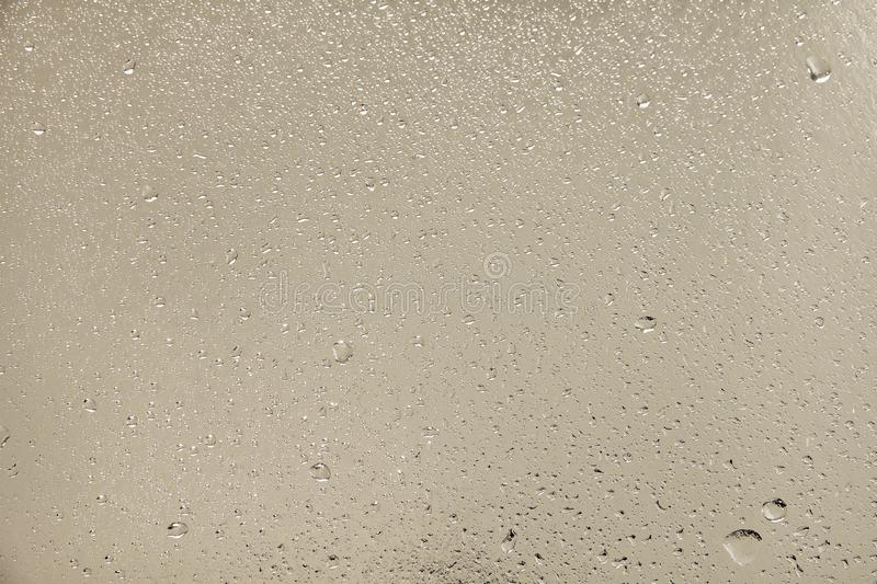 Water droplets on silver background. Water droplets on silver surface as abstract background royalty free stock images