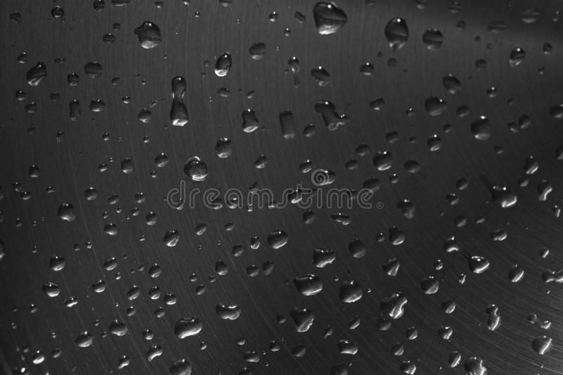 Water droplets on the steel plate. Metal background . Water droplets on the steel plate. Dark metal background, texture, water drops royalty free stock photos