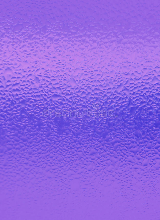 Water Droplets on Vibrant Purple Colored Bottle, for Abstract Background with Selective Focus. Water Droplets on Vibrant Purple Colored Bottle, Vertical Photo royalty free stock images